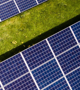 Fourth part of solar panels in meadow