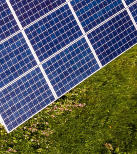 Eighth part of solar panels in meadow